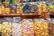 Different Kind Of Coockies Packed In Clear Plastic Bags Standing On A Shelve At A Stall At The Klong Toey Market In Bangkok, Thailand