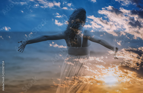 Fotografie, Obraz  Double exposure of young woman and sunset sky.