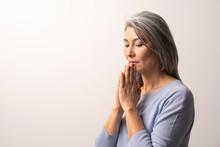 Mature Asian Woman Praying On White Background