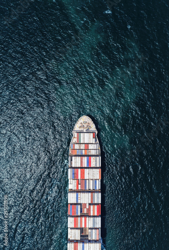 Fotografía  Aerial top view container ship full load container on the deep sea for logistic, import export, shipping or transportation