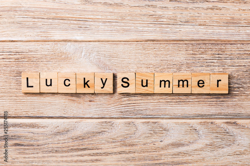 Photographie  Lucky Summer word written on wood block