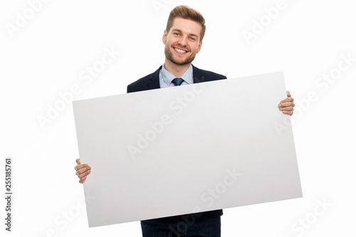 Obraz Business man holding white board - fototapety do salonu