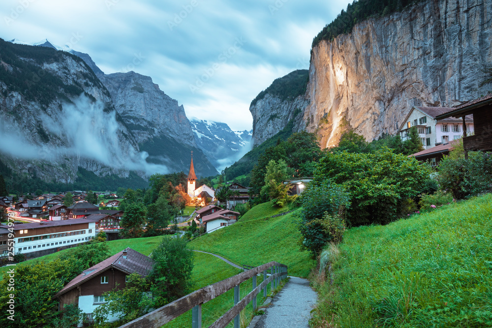 Fototapety, obrazy: Amazing touristic alpine village with famous church and Staubbach waterfall, Lauterbrunnen, Switzerland, Europe