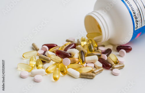 Fotografia  Vitamins, omega 3, cod-liver oil, dietary supplement and tablets