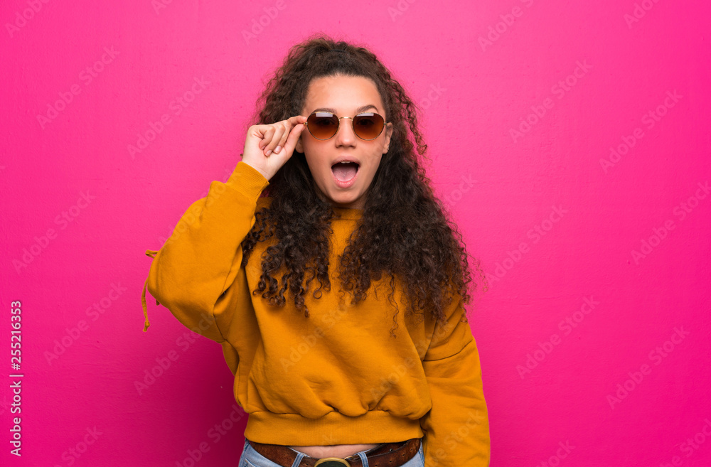 Fototapety, obrazy: Teenager girl over pink wall with glasses and surprised