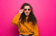 canvas print picture - Teenager girl over pink wall with glasses and surprised