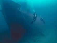 Scuba Diver In The Sea With Ship Wreck