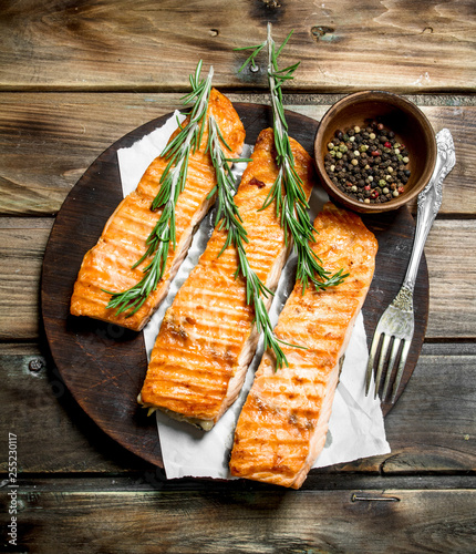 Fotografia, Obraz Grilled salmon fillet with spices and rosemary.