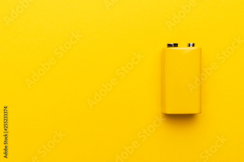 Fotografie, Obraz  blank nine-volt battery on the yellow background with copy space