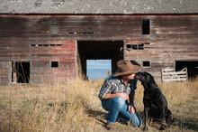 Cowboy Kissing Dog Outdoors