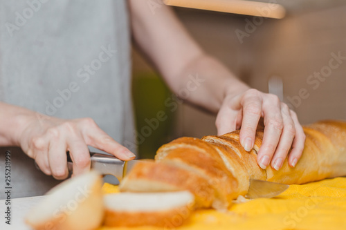 Autocollant pour porte Cuisine Fresh baked baguette bread on wooden cutting board - making sandwiches