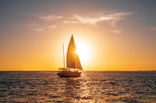 Sailing Yacht In The Ocean At Sunset