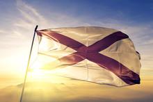 Alabama State Of United States Flag Waving On The Top Sunrise Mist Fog