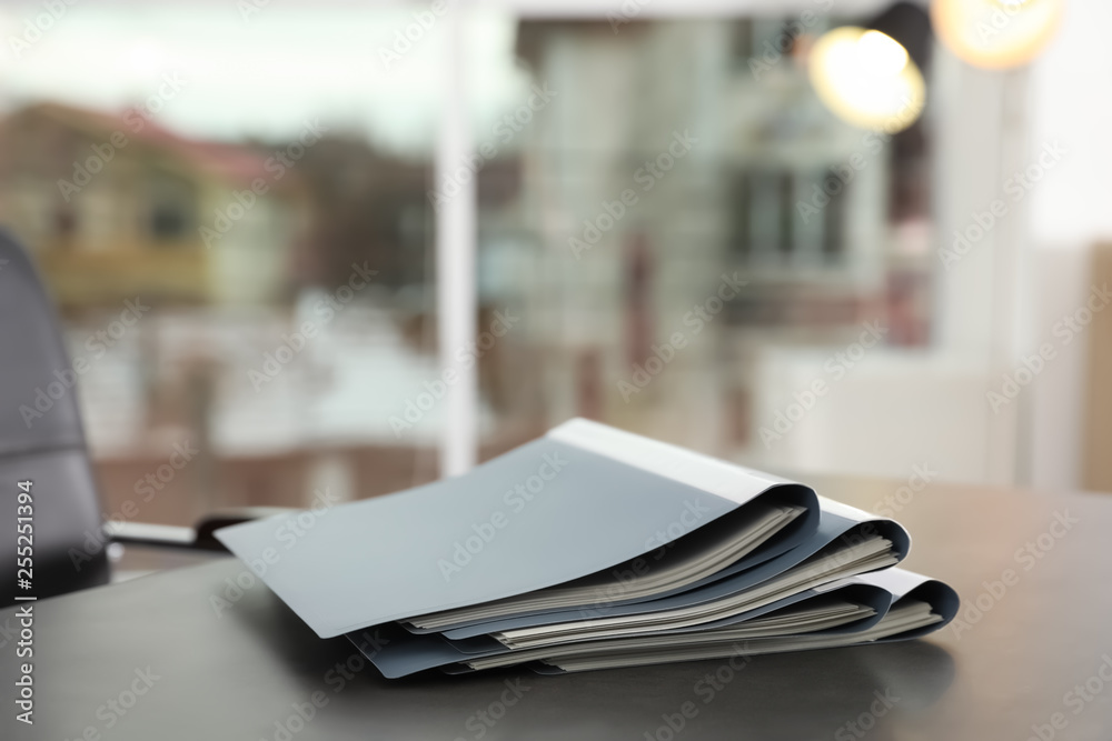 Fototapeta Stack of folders with documents on office table. Space for text