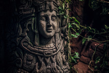 Beautiful Rocky Monument With A Carved Image Of A Human Face In The Jungle. Close-up View