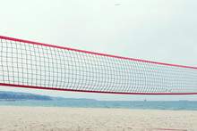 Red Volleyball Net On A Sea Shore Summer Time No People Selective Focus