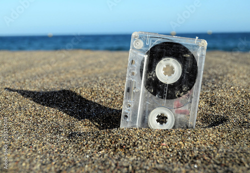 Ancient Retro Musicassette on the Sand - 255274314
