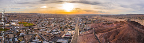 Fotobehang Las Vegas Aerial view of Barstow community a residential city of homes and commercial property community Mojave desert California USA at sunset