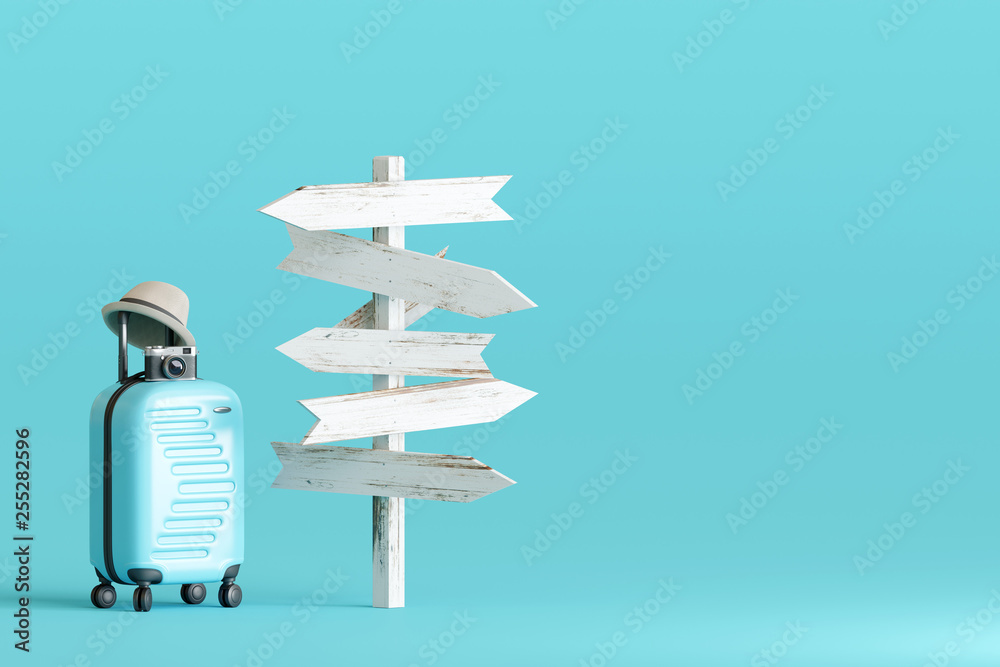 Fototapeta Blue suitcase and hat, camera with signpost on pastel blue background. travel concept. 3d rendering
