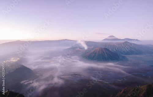 Papiers peints Lilas Wide angle view of Mount Bromo in the early morning. This is an active volcano part of the Tengger massif, in East Java, Indonesia.
