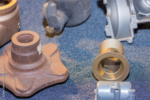 Valokuva many kind of product show before and after cleaning by shot blasting process and