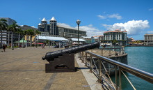 An Ancient Cannon In Port Louis