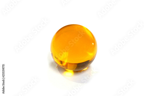 Photo  Crystal Ball yellow on a white background.