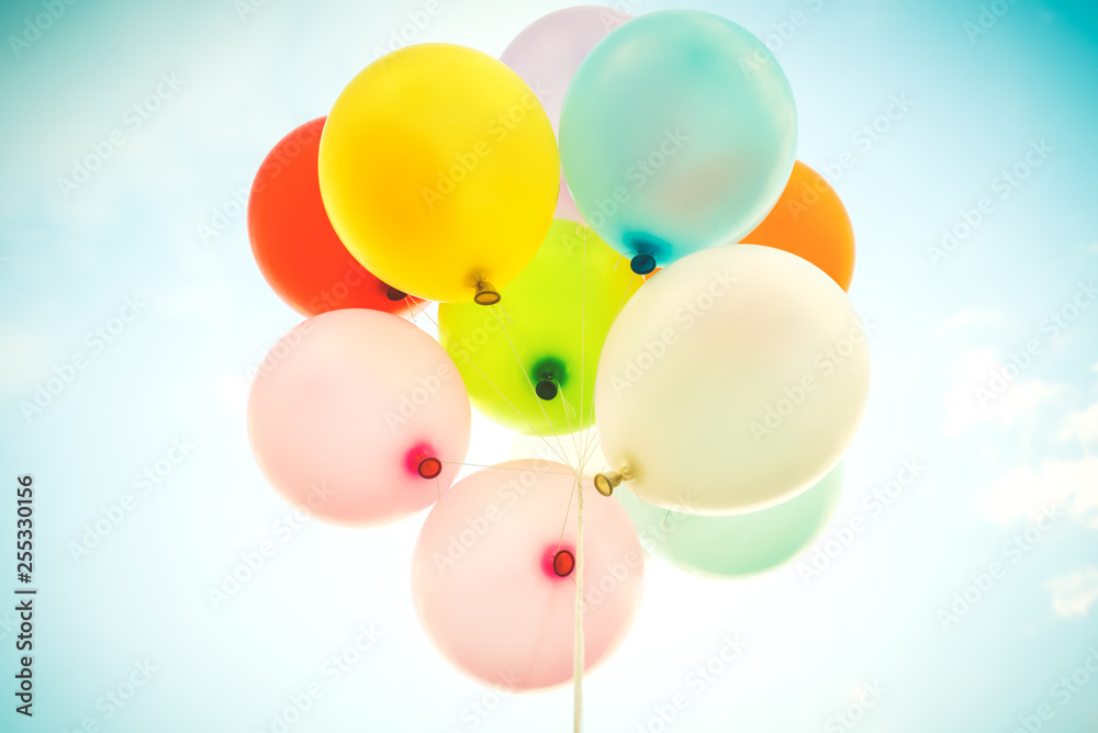 Fototapety, obrazy: Vintage multicolor balloons with done with a retro instagram filter effect on blue sky. Ideas for the background of love in summer and valentine, wedding honeymoon concept.