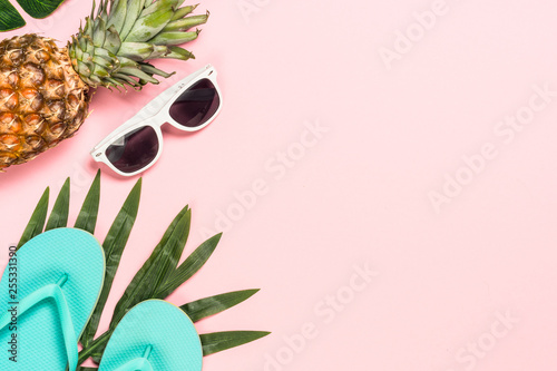 Summer flat lay background on pink.