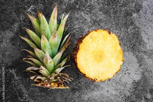 Fototapeta top view of pineapple sliced open on stone background obraz