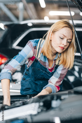 Photo  puzzled girl have problems with engine