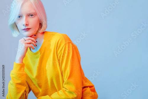 beautiful girl with pale skin dressed in yellow fashion trendy sweater, close up photo Tapéta, Fotótapéta