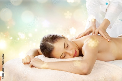 Fotografie, Obraz  Beautiful young woman relaxing with massage at beauty spa