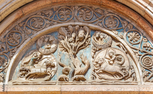 PARMA, ITALY - APRIL 17, 2018: The symbolic romanesque relief on the Baptistery.