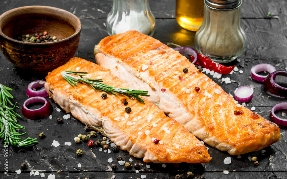 Fototapety, obrazy: Grilled salmon fillet with spices and herbs.