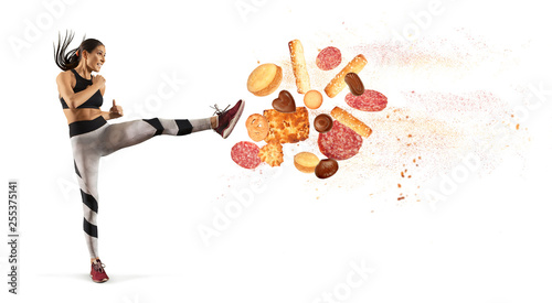 Fotografie, Obraz  Fit young woman fighting off bad food i