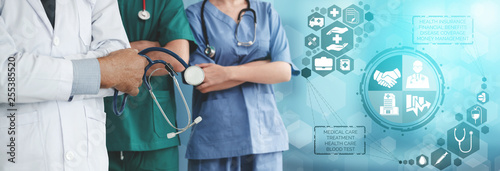 Fotografía Health Insurance Concept - Doctor in hospital with health insurance related icon graphic interface showing healthcare people, money planning, risk management, medical treatment and coverage benefit