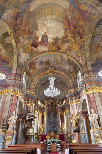 PRAGUE, CZECH REPUBLIC - OCTOBER 18, 2018: The baroque church Kostel Svaté Alexandrijské with the fresco in cupola by Václav Vavřinec Reiner (1689 - 1743).