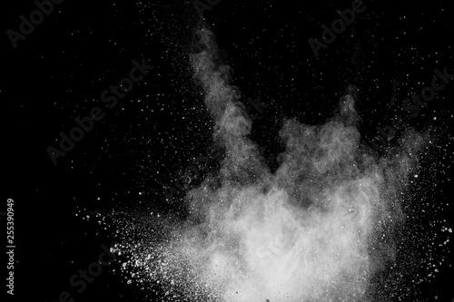 Foto  Bizarre forms of white powder explosion cloud against black background