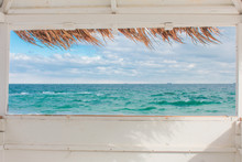 View From The Window Of The Bungalow On The Sea Landscape. Concept Vacation At Sea In The Summer.