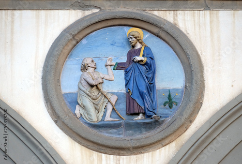 Photo Works of Mercy, glazed terracotta tondo by Andrea della Robbia, located between