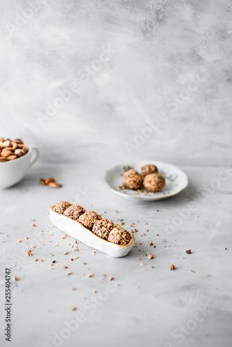 Fotografia  Bliss balls with chopped hazelnuts