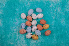 Easter Chocolate Quail Eggs On Light Blue Background.