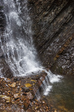 Waterfall In Carpathian Mountains. Stream Of Mild Water Surrounded By Wet Stones