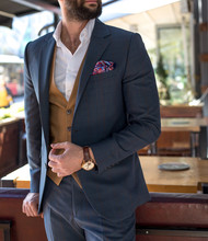 Man In Expensive Custom Tailored Suit With Beard Standing And Posing In Coffee Shop