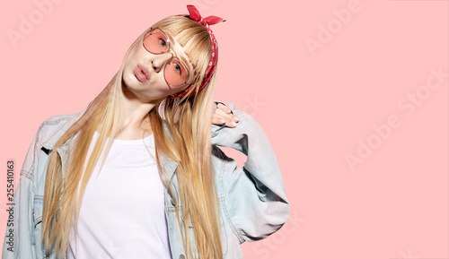 Fotografie, Obraz  Portrait of lovely young woman with long fair hair and stylish red bandage