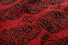 Close Up Of A Traditional Afghan Hand Knotted Elephant Foot Rug