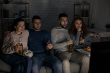 Friends Watching Horror Films And Eating Popcorn