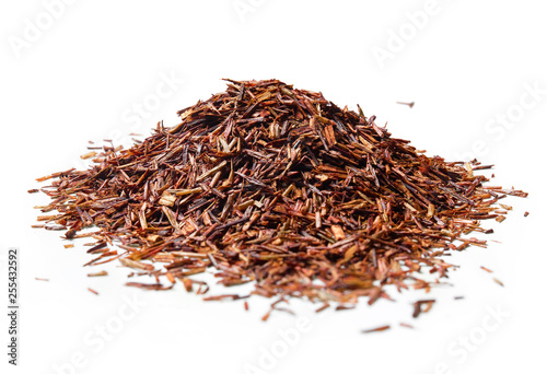 obraz lub plakat Heap of Rooibos tea on white background. Close up. High resolution