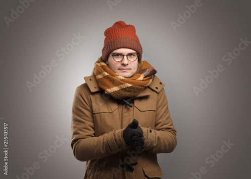 Fotografía  Handsome young boy freezing in warm clothing with copy space